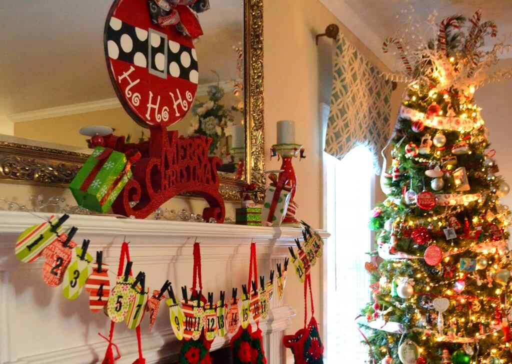 I absolutely love this red and green whimsical mantel from Life on the Bay Bush!