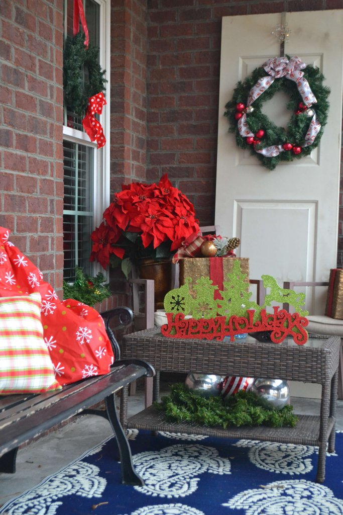 This old door on the porch adds an extra spot to hang a wreath or other seasonal decor