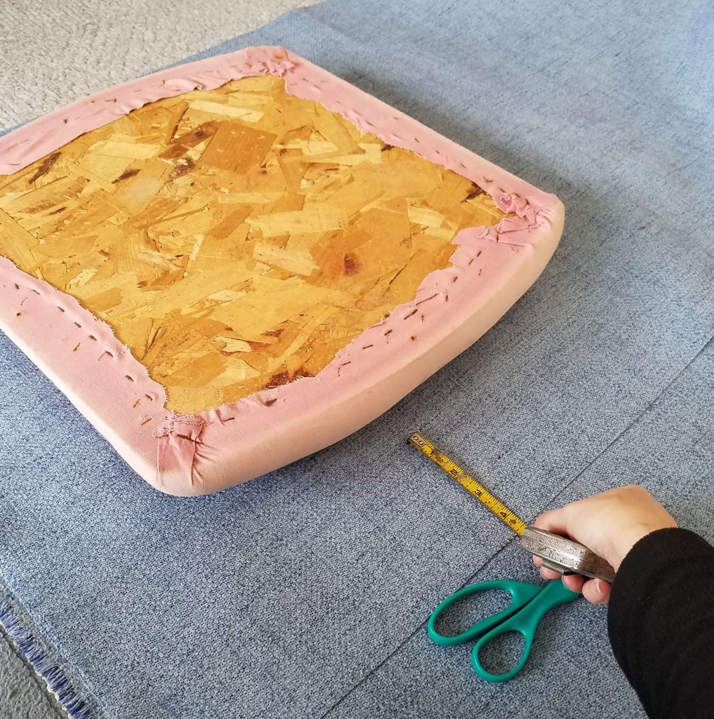 I used the cushion and old fabric as a guide to cut the new fabric.