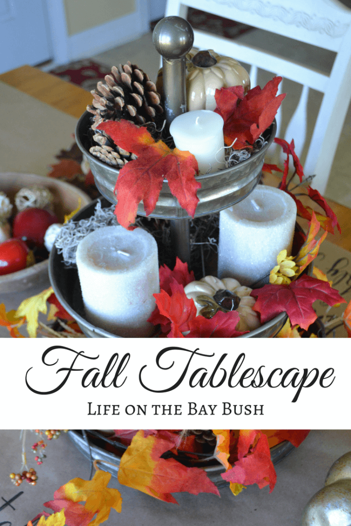 Cute and easy Fall Tablescape using a 3 tiered tray, hand lettered brown wrapping paper and lots of Fall accents to set a warm and cozy table for Fall!